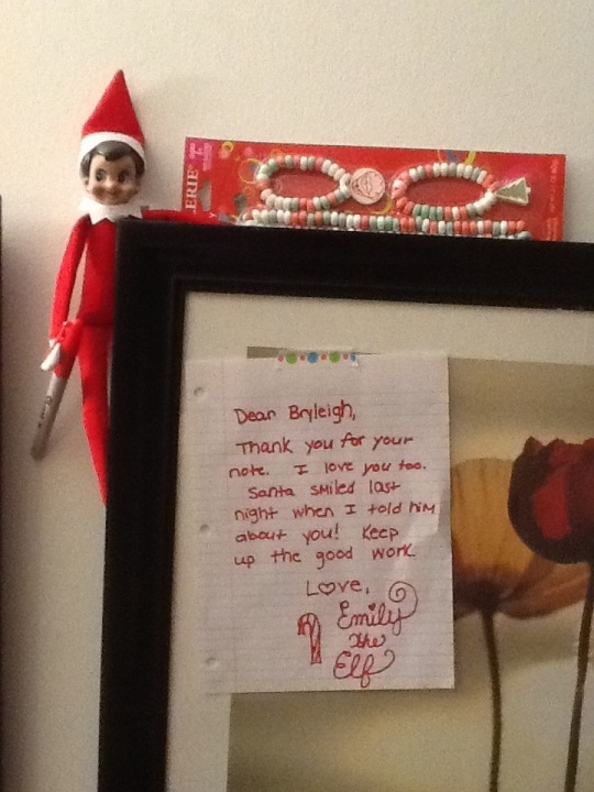 Our Elf left a note (she's still holding the sharpie!) and left some candy jewelry